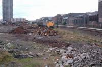 26011 shunting scrap wagons in the former Camlachie Goods Yard, here reduced to a single track serving a scrapyard in 1988. [See image 51978]<br><br>[Ewan Crawford //1988]