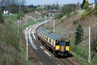 318262 coming round the reverse curves south of Carluke on the approach to Braidwood.<br><br>[Ewan Crawford 21/04/2015]