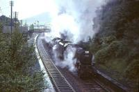 Black 5 45359 and an unidentified classmate struggle to restart a long train of empty stock from the up loop and on through Abington station on 30 July 1966 during heavy rain. [See image 51334]  <br><br>[John Robin 30/07/1966]