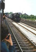 Photograph taken from a carriage window of <I>Scottish Grand Tour no 5</I> on the WCML near Carnforth on 1 June 1968. Lostock Hall Black 5 44942 is approaching from the south with a parcels train.<br><br>[John Robin 01/06/1968]