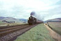 Black 5 44993 deputising for a diesel on a Glasgow - Manchester train in September 1964, photographed running to time north of Abington.<br><br>[John Robin 26/09/1964]