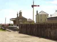 Looking seaward to the former West Bay station south of Bridport, showing the sleeper wall erected along the approach track-bed and the departure home signal that stands guard north of the station. West Bay saw its last rail passengers in September 1930.<br><br>[David Pesterfield 12/05/2015]