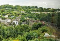 View of the famous Calstock viaduct from the left hand window of a Gunnislake bound Sprinter cautiously rounding the approach curve on the Devon side. The Tamar river is the county boundary and Calstock village in Cornwall can be seen on the far side of the bridge.<br><br>[Mark Bartlett 29/07/2015]