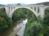 The impressive 1885 Pont ferroviaire de Ceret viaduct, across the Le Tech river at the eastern side of Ceret, on the remaining section of the branch line that originally ran from Elne to Arles-sur-Tech; but no longer exists beyond the former Ceret station sited some 700 metres to the left. Most of the final section between St-Jean-Pla-de-Corts yard and Ceret station is now mothballed and overgrown.  <br><br>[David Pesterfield 01/08/2015]