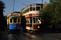 In late autumn morning sunshine the Beamish tramway prepares for a busy Sunday. Both vehicles advertise a Department Store well known to generations of North East shoppers.<br><br>[Brian Taylor 01/11/2015]