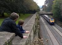 Sydney Gardens, Bath has long been a classic location to watch and photograph trains. This is the High Level viewing gallery [see image 52886]. A father and son enjoy the spectacle as an up HST powers away from Bath Spa through the gardens.<br><br>[Ken Strachan 10/10/2015]