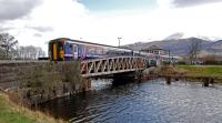 The midday service to Mallaig crosses Banavie Swing Bridge over the Caledonian Canal in 2013.<br><br>[Ewan Crawford 27/04/2013]