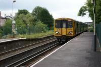 A Merseyrail service from Hunts Cross to Southport approaches Ainsdale station on 26 June 2011. The height of the unused section of the Up platform is considerably lower than the rest.<br><br>[John McIntyre 26/06/2011]