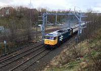 An unidentified  electric multiple unit, sandwiched between two translator coaches, is hauled by 47805 up the gradient towards  Eastfield on 23rd December 2015.<br><br>[Colin McDonald 23/12/2015]