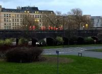 An orange army - or at least a small detachment therefrom - attending to the viaduct West of Bath Spa station at dusk on Boxing Day 2015.<br><br>[Ken Strachan 26/12/2015]