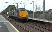 DRS 37609+37607 working the diverted 6M22 south through Barassie from Hunterston LL to Sellafield on 7 January 2016. This train normally runs via Kilwinning<br><br>[Ken Browne 07/01/2016]