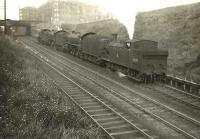 A locomotive quartet on its way from Eastfield shed to Queen Street station descending Cowlairs Incline on 6 September 1955. Leading is N15 69179, followed by B1s 61396 and 61134. Bringing up the rear is D49 62716 <I>Kincardineshire</I>. The first three are residents of 65A, while the D49 is a visitor from Thornton Junction.<br><br>[G H Robin collection by courtesy of the Mitchell Library, Glasgow 06/09/1955]