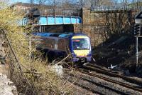 170403 on a service from Dunblane to Glasgow Queen Street passes overbridge 123, a structure which is shortly (March 2016) to be removed as part of the EGIP works.<br><br>[Colin McDonald 07/03/2016]