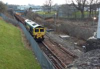 Works have commenced on the Cowlairs Incline out of Glasgow Queen Street.<br><br> <br><br> 66.520 (and another unidentified 66) with a PW train on the Cowlairs Incline viewed looking south from Keppochhill Road. Some track lifting has already occurred near to the camera.<br><br>[Rod Crawford 20/03/2016]