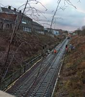 Evening shift clipping new rails onto sleepers set at new lower level to accommodate OHLE.<br><br>[Martin MacGuire 30/03/2016]