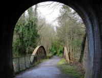 On leaving the west portal of Auchendinny tunnel, trains on the Penicuik Railway crossed a bowstring girder bridge over the North Esk before reaching the station. The surviving platform stands on the left immediately beyond the bridge in this view from the tunnel on a bright but chilly morning in March 2016. The route now forms part of a walkway.  <br><br>[John Furnevel&nbsp;28/03/2016]