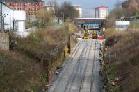 View up the Incline from Pinkston Road. Rail mounted cement mixers and Road/Rail Vehicles can be seen parked at the Keppochhill Drive/Fountainwells access point. Above them can be seen the blue painted Fountainwells overbridge which is scheduled for demolition soon.<br> <br><br>[Colin McDonald 15/04/2016]
