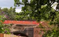 Quite a contrast between the arch over the down lines (left) and that over the up lines (right). The bridge carries Grove Lane over the railway, and provides the only access to the station. The brick wall on the South side collapsed on Monday night, 1st August 2016.<br><br>[Ken Strachan 03/08/2016]
