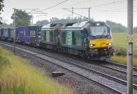 DRS 68004 and 68017 with the Tesco Daventry - Mossend service at Fiddlers Gill, south of Braidwood.<br><br>[Bill Roberton 12/08/2016]