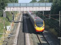An Edinburgh to Euston Pendolino heads towards Preston near Barton and Broughton on 29th August 2016. The signal on the left controls access to the Down Loop, which can just be seen under the bridge that carries a local water main. This stretch of the WCML had four tracks until around the time of electrification in the early 1970s. [Ref query 3350]  <br><br>[Mark Bartlett 29/08/2016]