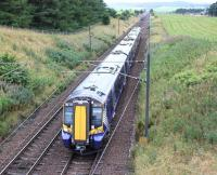ScotRail 380110 heads north from Carstairs East Junction shortly after the Carstairs stop on 31 July 2016 with the 0831 Ayr - Edinburgh via Glasgow Central.<br><br>[John Furnevel 31/07/2016]