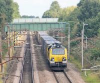 Freightliner 70005 and the Coatbridge to Daventry containers head south at Barton & Broughton on the August Bank Holiday, 2016. This image taken from the bridge that carries the <I>Guild Wheel</I> over the WCML. The Guild Wheel is a 21 mile circular cycle route around the City of Preston. Its other WCML crossing is under the Ribble Viaduct immediately south of Preston Station.  <br><br>[Mark Bartlett 29/08/2016]