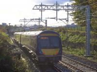 The wiring on the north end of the Cowlairs Incline looks almost complete as the 1306 arrival from Edinburgh descends in the afternoon sunshine on 5th November 2016. However, the supports cease before the Pinkston Road overbridge and there's no knitting yet for some distance up the hill from there.<br><br>[Colin McDonald 05/11/2016]