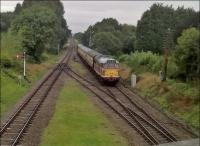 Bet the trees weren't that lush in steam days. But the class 31 in original butterscotch livery looks very 'sixties'. View looks North, from the road overbridge.<br><br>[Ken Strachan 10/09/2016]