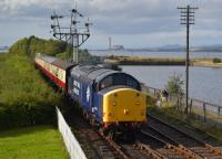 On-loan DRS 37703 enters Bo'ness with the closed Longannet Power Station in the background.  Due to a breach in the BKR by pipeline work, trains were being topped and tailed; on this occasion NCB no.19 brought up the rear.<br><br>[Bill Roberton 04/10/2016]