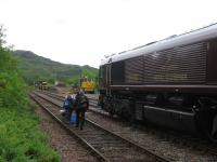Barrow crossing no more - the Mallaig-bound Royal Scotsman blocks authorised egress by ScotRail passengers from the eastbound platform at Arisaig on 11th June 2016.<br><br>[David Spaven 11/06/2016]