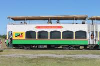 A double decked St Kitts Scenic Railway coach. The five in use are substantial vehicles, built in the USA around 2002. The lower saloon is air conditioned with loose wicker seating and tables - very colonial. The popular upper decks have longitudinal benches and are completely open apart from the canopy cover - ideal for en route photography.