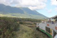 The St Kitts Scenic Railway train running north alongside the range of volcanic mountains that overlook the Atlantic Coast.
