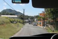 A former level crossing in Sandy Point Town, St Kitts, immediately to the south of the La Vallee limit of rail operations. This view was taken from a bus returning rail passengers to Basseterre to complete the circular trip. The twelve mile disused section of line can be seen at various points from this road along the west coast.