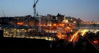 Early morning at Waverley in January 2006 with the lights of the new Edinburgh Council HQ construction site taking up most of the foreground of the picture.<br><br>[John Furnevel 03/01/2006]