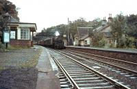 Platform view south at Abington on 26 September 1964 as Black 5 44672 runs through the station with a down freight.<br><br>[John Robin 26/09/1964]