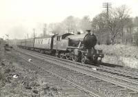 Parkhead V3 67679 photographed near Bowling on 12 April 1958 with a Balloch - Milngavie train.  <br><br>[G H Robin collection by courtesy of the Mitchell Library, Glasgow 12/04/1958]