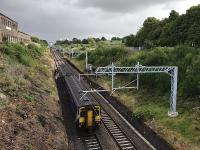 With a few days to go before the wires were energised, 156500 on an Anniesland service climbs noisily out of the tunnel and under the substantial metalwork which is now a feature of the line. The OHLE remains under test until October 2017, with no electric traction permitted before then. <br><br>[Colin McDonald 30/08/2017]