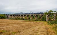 A westbound train crossing the Avon Viaduct, Linlithgow. Wires up and looking ready for electric trains. View looks south.<br><br>[Ewan Crawford 08/10/2017]