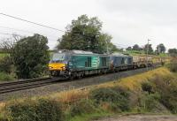 DRS 68017 <I>Hornet</I> and nearly new 68032 take the Sellafield to Crewe flasks south through Bay Horse on Saturday 7th October 2017. <br><br>[Mark Bartlett 07/10/2017]