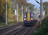 380 101 approaches with a service from Gourock.  To the left was the branch to ROF Bishopton; the junction has been removed but some track remains in the trees.  20 October.<br><br>[Bill Roberton 20/10/2017]