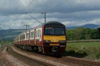 A pair of Class 320 units with 320307 leading, skirt the River Clyde approaching Brooks Road user worked LC between Ardmore East and Cardross on 28 May 2010. <br><br>[John McIntyre 28/05/2010]