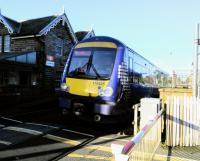 Up close and personal. An Edinburgh to Inverurie service pulls out of<br> Broughty Ferry and over the level crossing on 25th October 2017. The service here is not great, though better than the token one it had for many years. It suffers, like Invergowrie, for being a suburban location with no suburban service. Broughty Ferry and Invergowrie will have an hourly service from May 2019.<br> <br><br>[David Panton 25/10/2017]