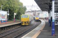 The Leaf Train on route to Airdrie passing a Milngavie service at Coatbridge Sunnyside.<br><br>[Alastair McLellan 23/10/2017]