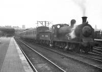 Ex-Caledonian 0-6-0 57630 prepares to take a local out of Buchanan Street in July 1949. <br><br>[G H Robin collection by courtesy of the Mitchell Library, Glasgow 04/07/1949]