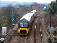 333001 pulls away from Ben Rhydding with an Ilkley to Leeds service as 333012 approaches with another Wharfedale line service from Bradford to Ilkley on 19th December 2017. <br><br>[Mark Bartlett 19/12/2017]