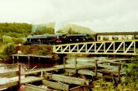 Black 5 Alderman A.E Draper 5305 crossing Banavie swing bridge on its way to Mallaig in August 1987. Thirty years later this loco is still on the main line. <br><br>[Gordon Steel 16/08/1987]
