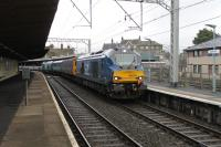 Another Class 68 <I>Cumbrian Coast</I> crew training run from Carlisle arrives in Carnforth on 19th January 2018. 68029 has just two coaches and 68003 <I>Astute</I> in tow and is signalled into the loops for a lunchtime break before the return run. <br><br>[Mark Bartlett 19/01/2018]