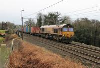 An MOD train ran to Glen Douglas from Fenny Compton on 24th January 2018. Grubby DB 66099 is seen passing Bay Horse with the short train of containers.<br><br>[Mark Bartlett 24/01/2018]