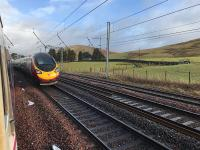The tail end of a Virgin Pendolino disappears north (photographed from a much delayed Caledonian Sleeper waiting for it to pass in the loop at the former Abington station). <br><br>[Colin McDonald 10/02/2018]
