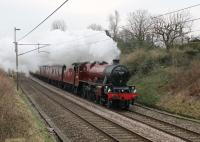 Despite the severe weather closing many lines in the UK <I>The Pennine Limited</I> steam excursion from Carnforth to Sheffield ran on 3rd March 2018. However, instead of the anticipated double-headed 45407 and 45690, the train was entrusted to 45699 <I>Galatea</I> with diesel support on the rear. Seen here passing the St. Heliers footbridge on the outward leg.  <br><br>[Mark Bartlett 03/03/2018]
